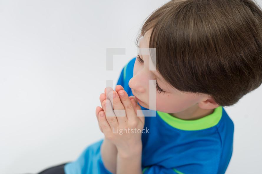 Boy praying.