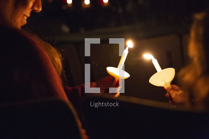 lighting candles during a candlelight service