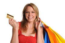 retail therapy - woman holding shopping bags and credit cards
