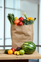 produce in a paper grocery bag