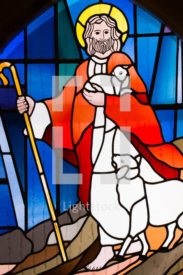stained glass window of Jesus as a shepherd