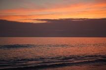 Rolling ocean tide at dusk.