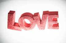word LOVE in red and glitter letters
