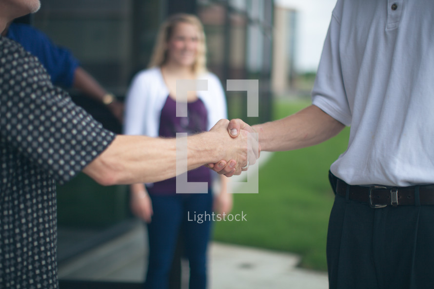 welcoming handshakes at the entrance of a church