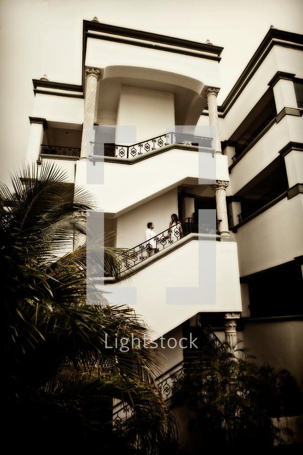 stairway of apartment building - people walking up