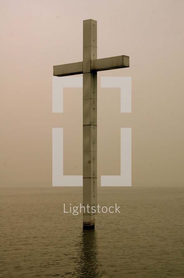 cross rising out of water