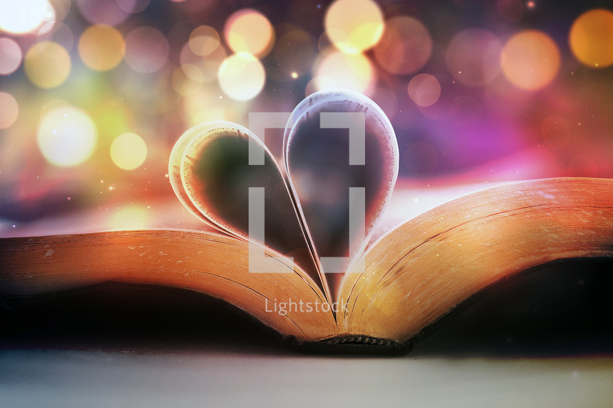 pages of a Bible folded into the pages of a heart