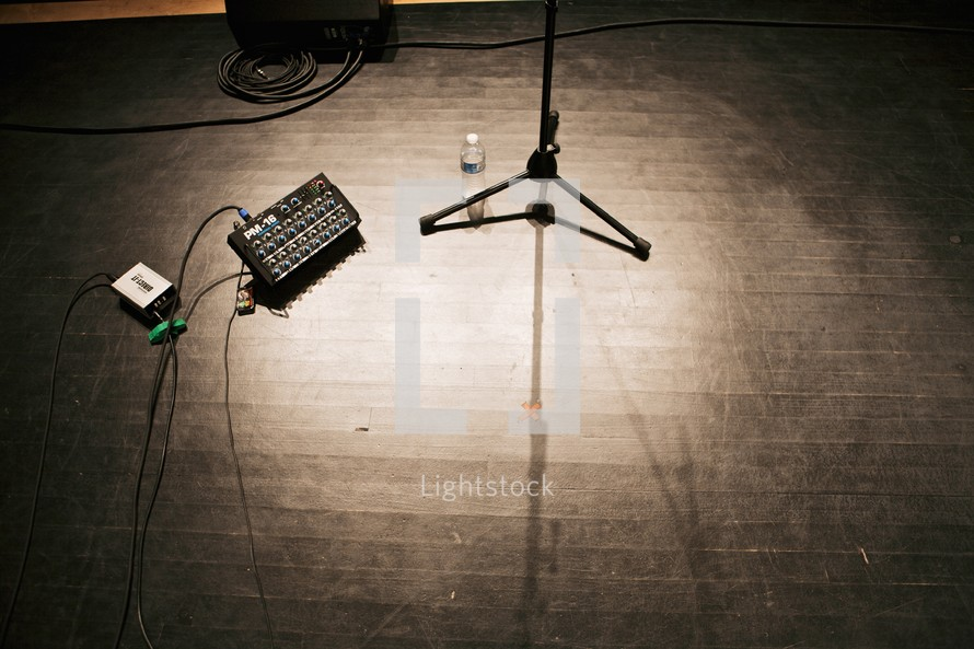 sound board and microphone stand on a stage