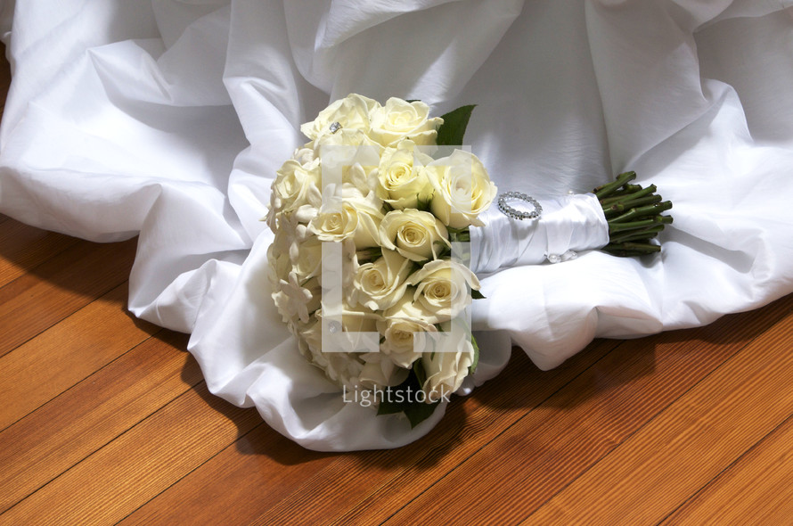 bouquet of white roses on a bridal gown