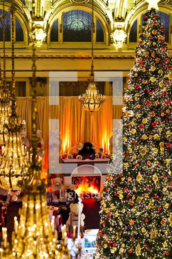 large Christmas tree and teddy bears in a hotel lobby december fireplace