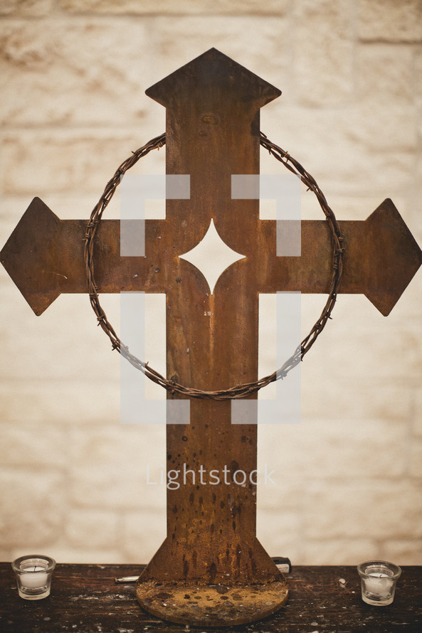 crown of thorns hanging on a cross