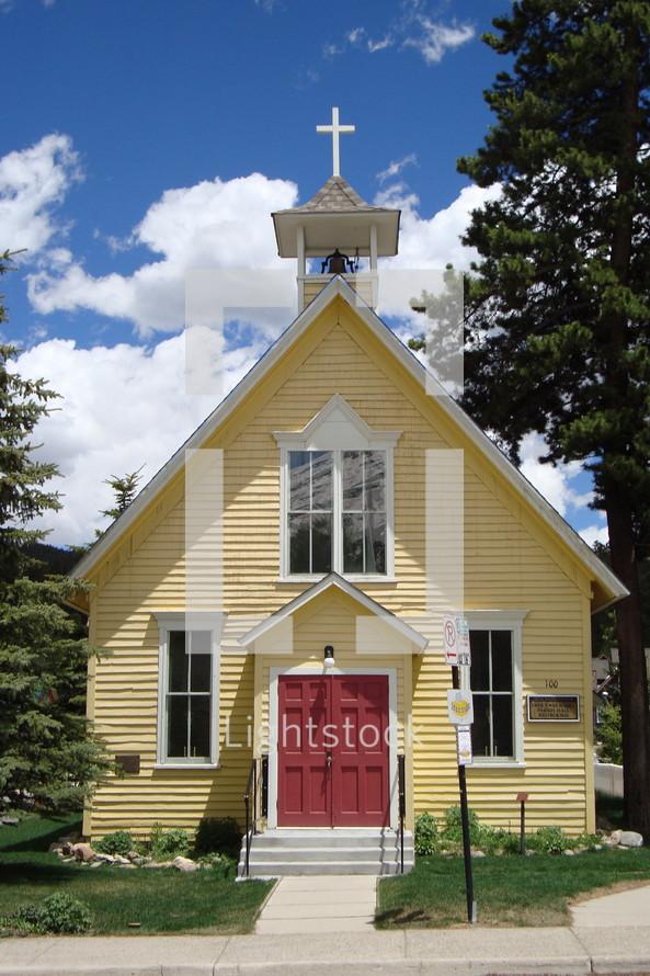 Small yellow rural church house