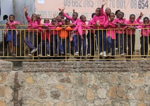 African school children standing on a balcony