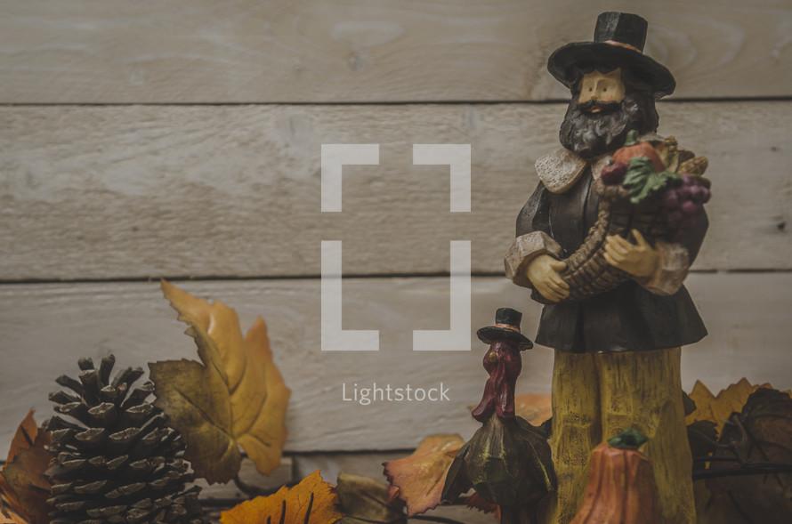 pilgrim and turkey figurines on a mantel