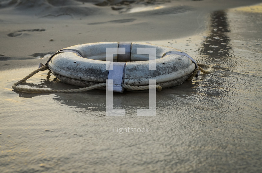 life ring on the beach