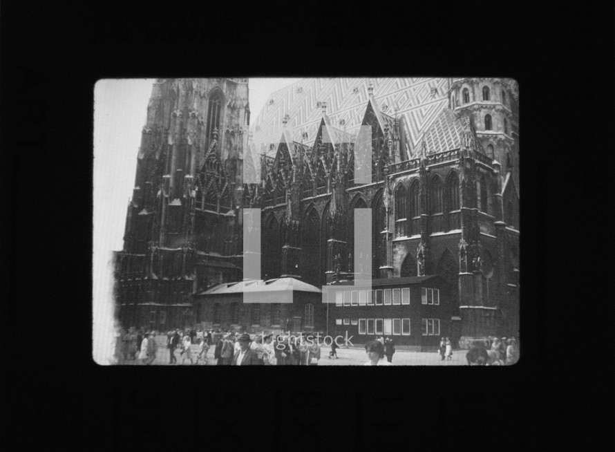 vintage photograph of a cathedral and pedestrians
