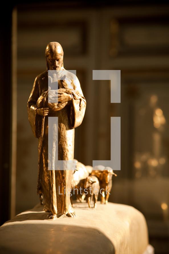 Statue of Jesus leading sheep