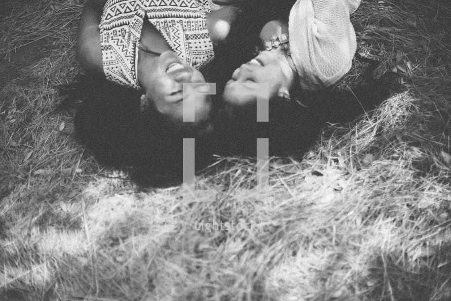 friends lying in straw
