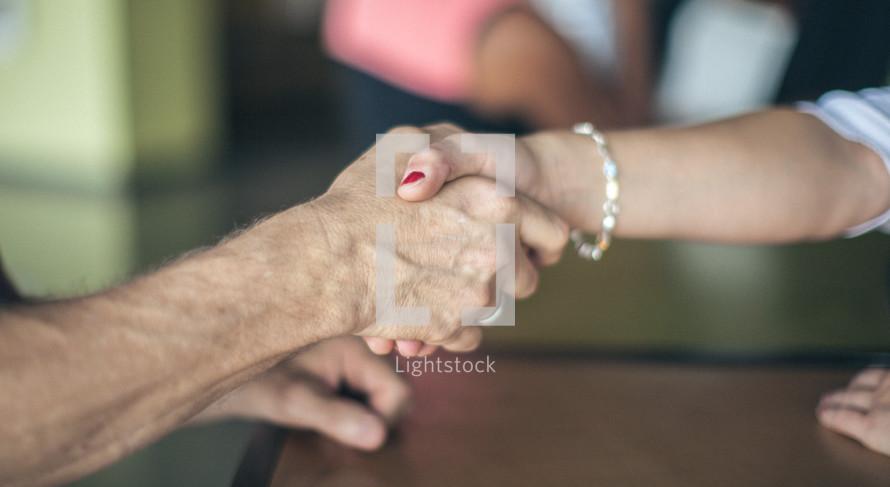 welcoming hand shake