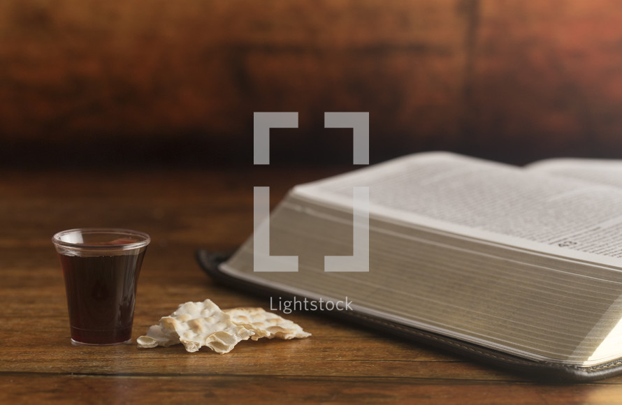 communion elements and an open Bible