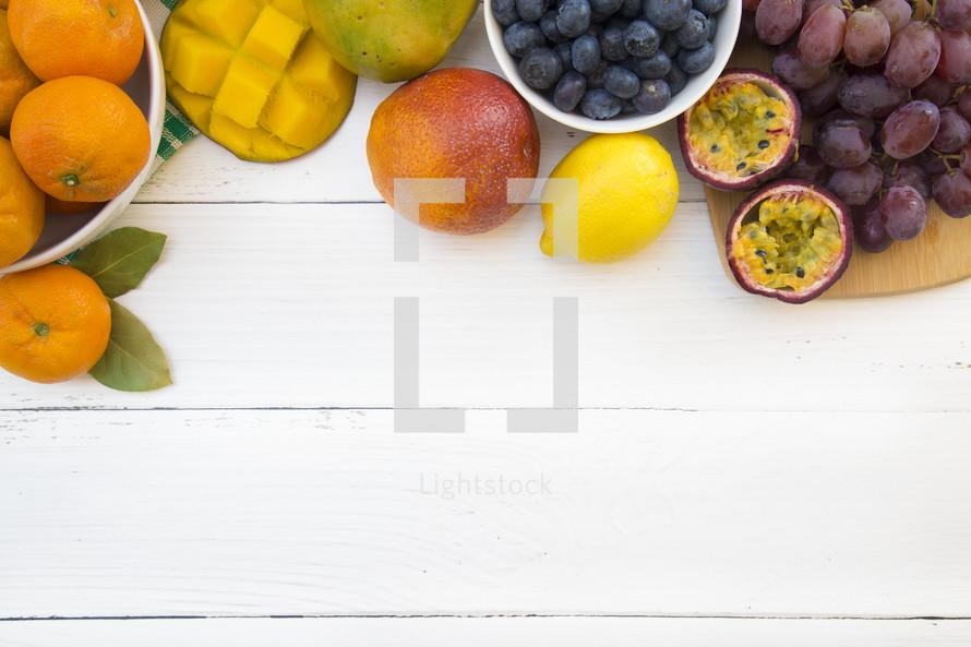 fruit border on a white wood background