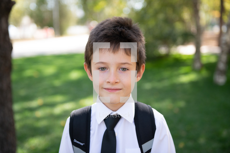 portrait of a child in dress clothes