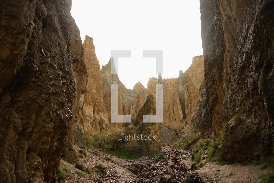 jagged mountain peaks around a canyon