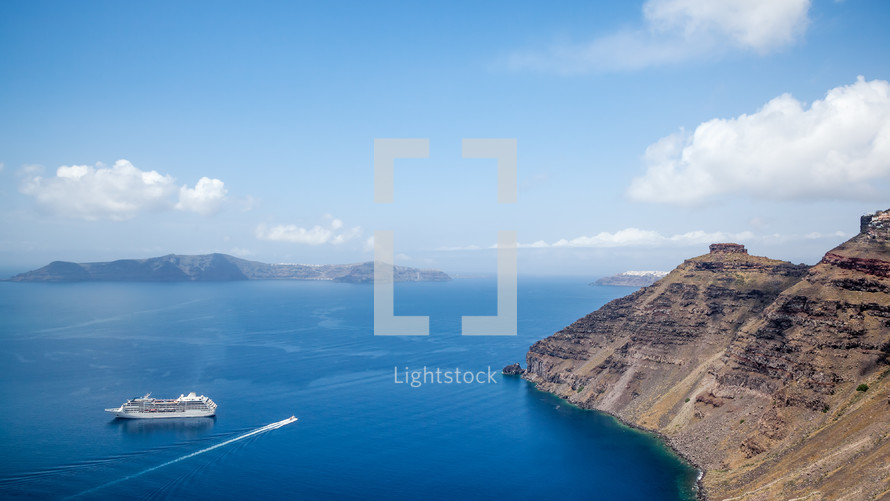 sea cliffs and cruise ship in Santorini