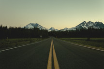 Yellow double line on an asphalt road | Depth | Perspective | Mountains | Early Morning