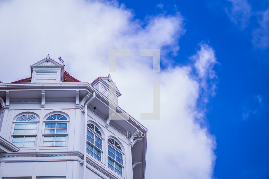 top of a white house under a blue sky