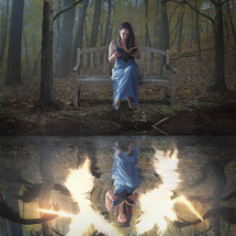 reflection of a woman reading a Bible sitting on a bench and a battle between good and evil below her (angels and demons battle)