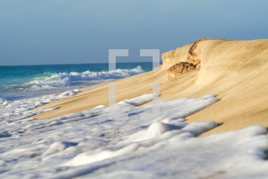sea foam on the sand