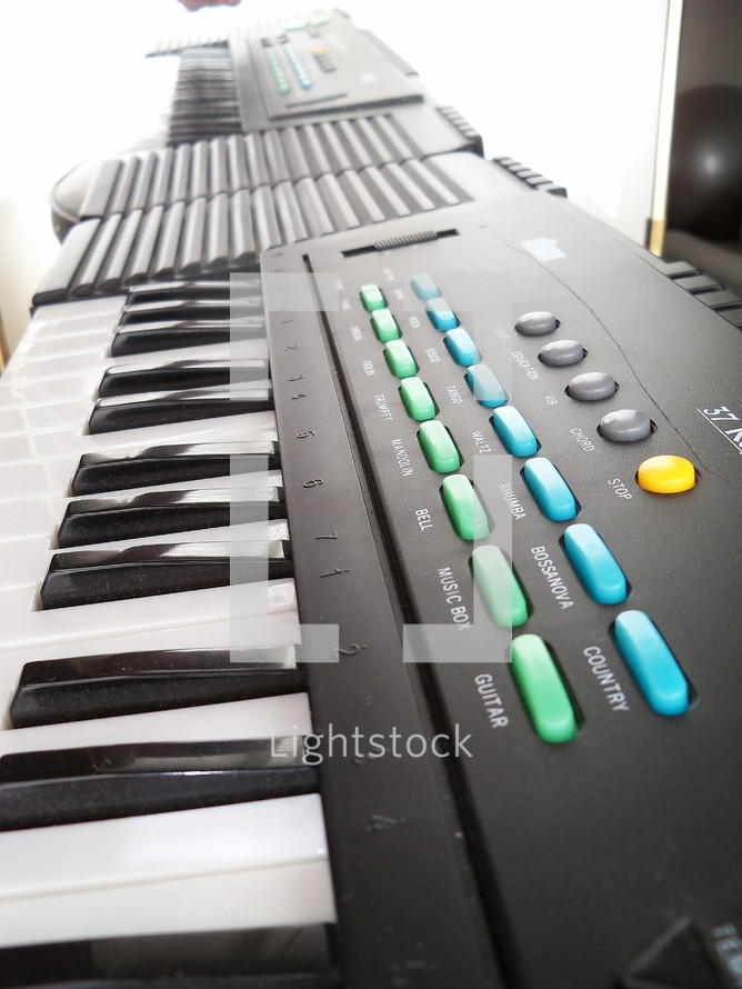 An Electronic Keyboard used in live band worship, praise concerts and recording of electronic church and Christian music with different synthesizer programmable keyboard elements such as guitar,  brass horns and other emulated sounds for playing before live audiences or mixing recorded music in the studio.