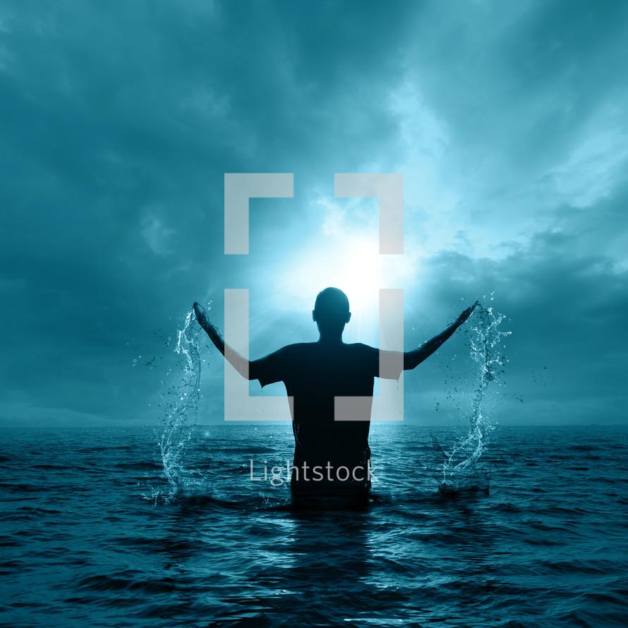 man splashing in water