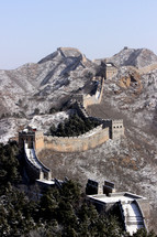 The Great Wall of China in mountains in the winter.