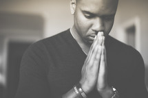 African-American man with praying hands