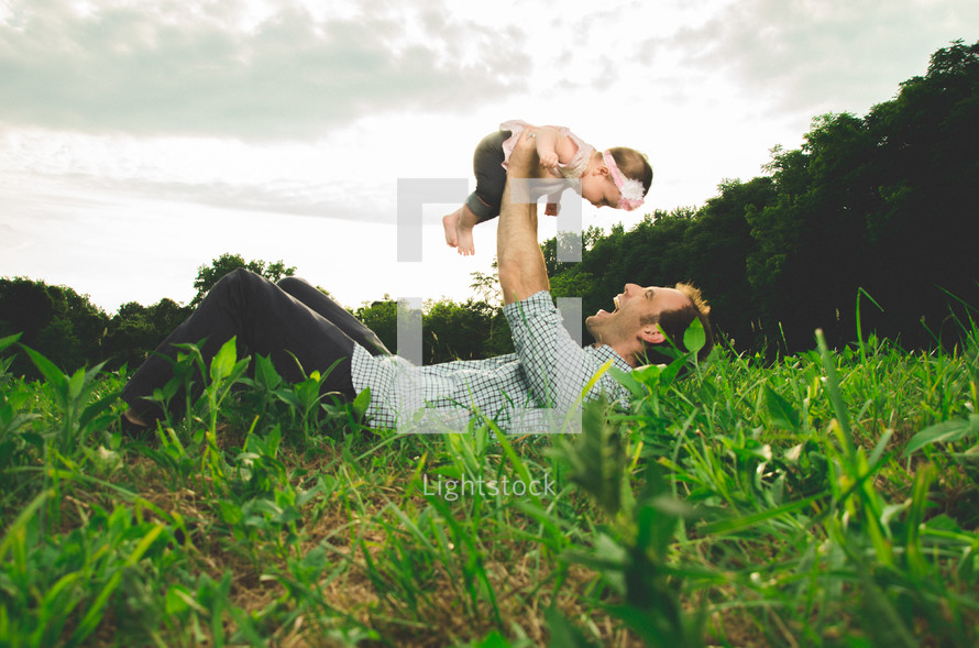 Father holding his daughter in the air