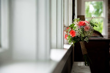 A wedding bouquet in a sunny window.