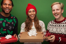 people holding gifts at a holiday party