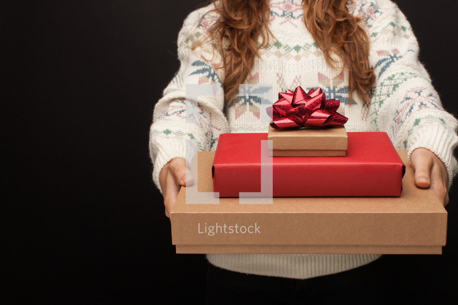 a woman giving gifts at Christmas