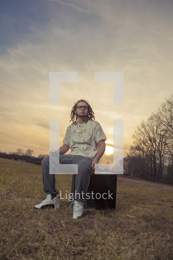 young man sitting outdoors