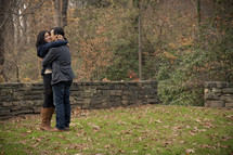 woman hugging a man after saying yes to his marriage proposal