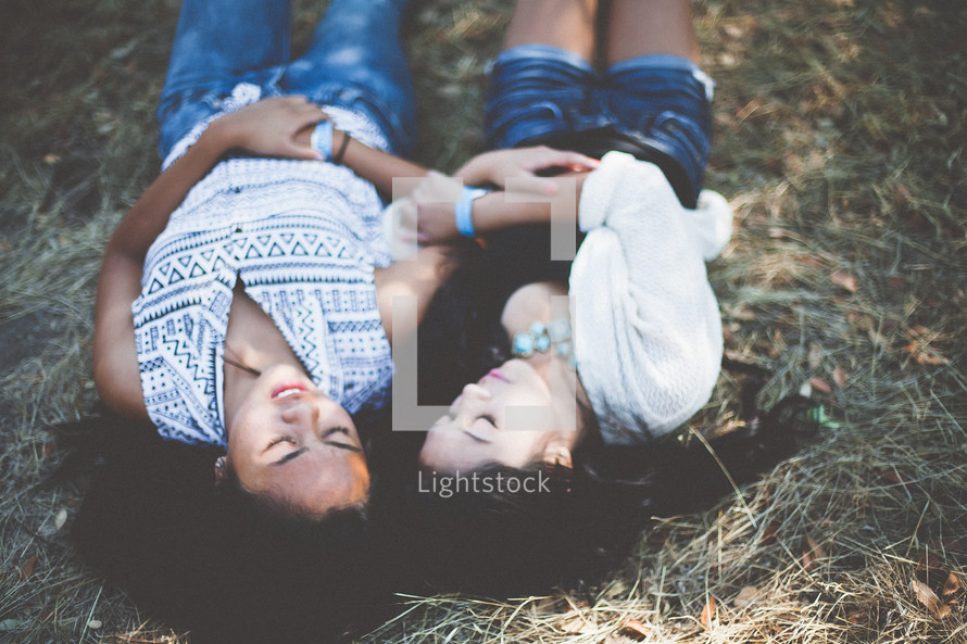 Friends lying in the straw