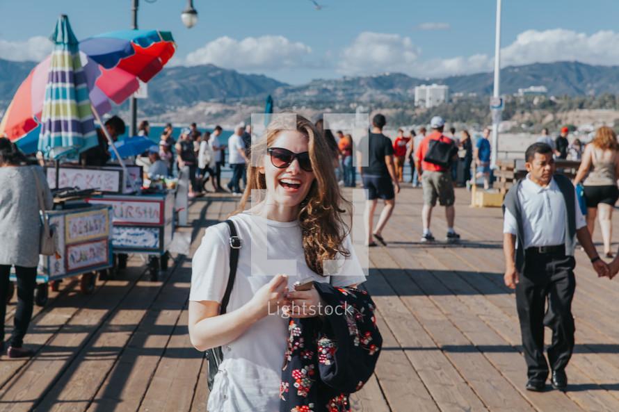 happy woman on a pier