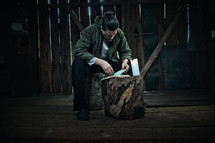 a man in a barn reading a Bible
