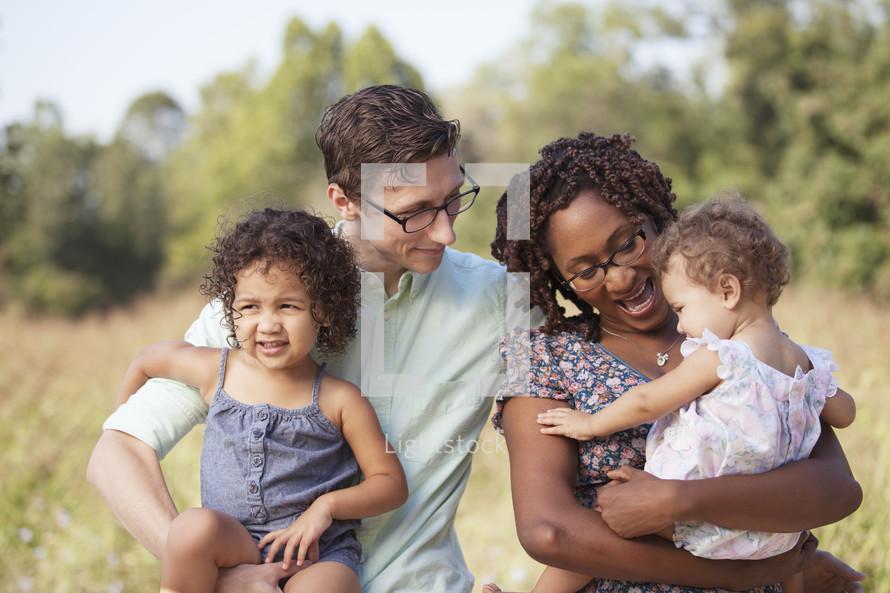 Happy multi-racial family outdoors.
