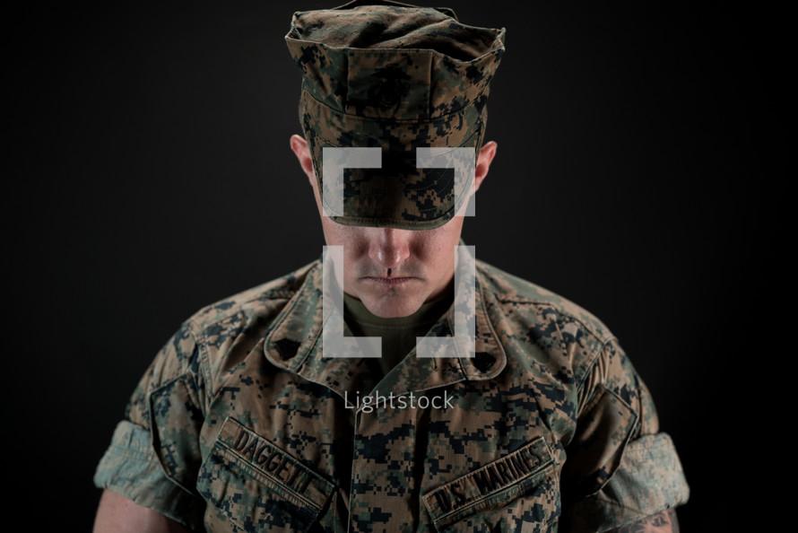 a soldier praying