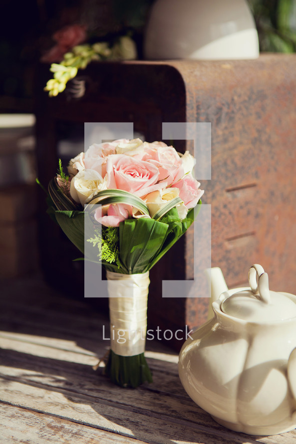 Wedding bouquet standing upright on tabletop. Vintage set up.
