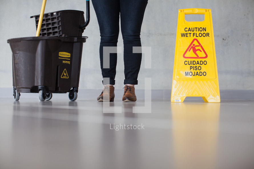 woman mopping a lobby floor