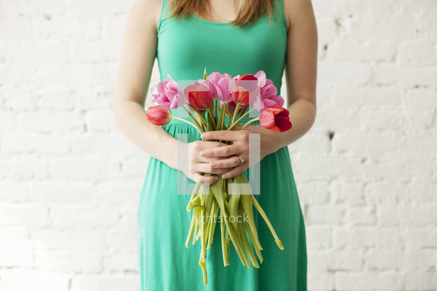 woman holding a bouquet of tulips